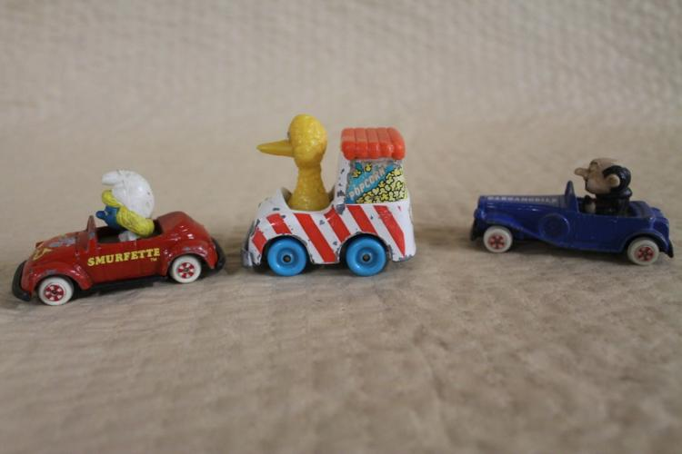 Lot of 3 toy cars with classic characters