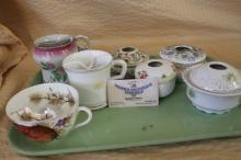 Lot of various teacups, hair receivers, and mustache cups