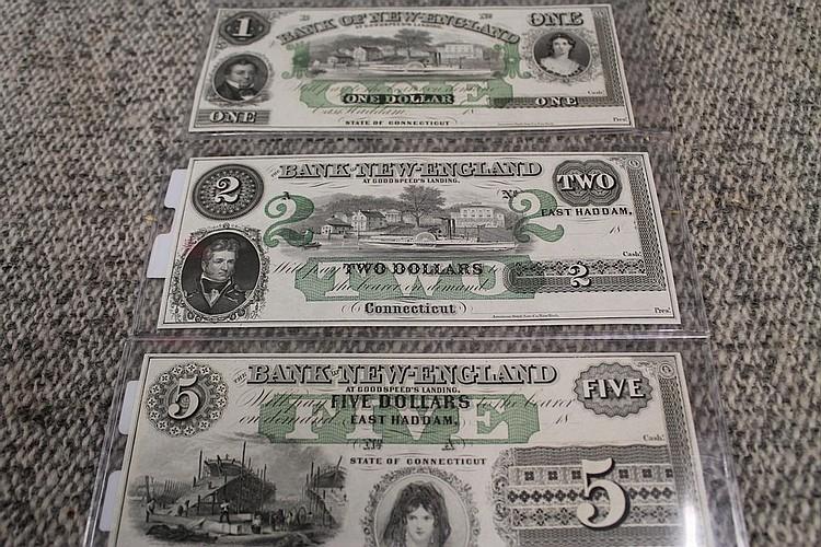 Three uncirculated Bank of New England bills
