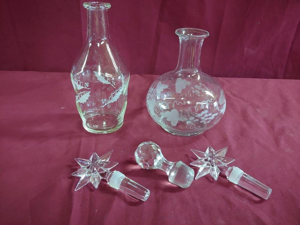 Two Glass Decanters and Three Stoppers