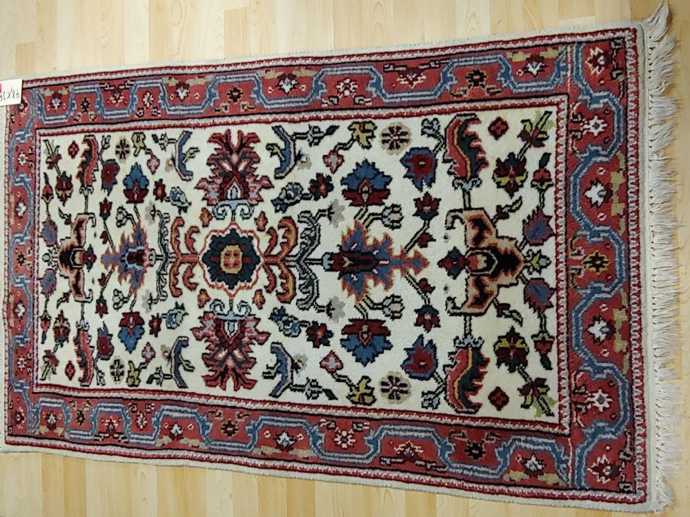 Small Tan-Red Rug