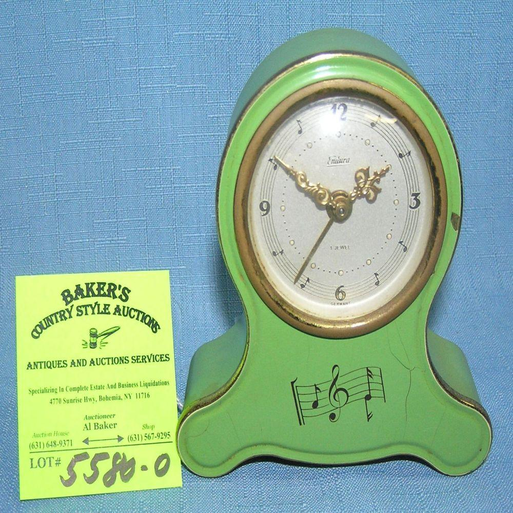 Antique musical alarm clock with jeweled movement