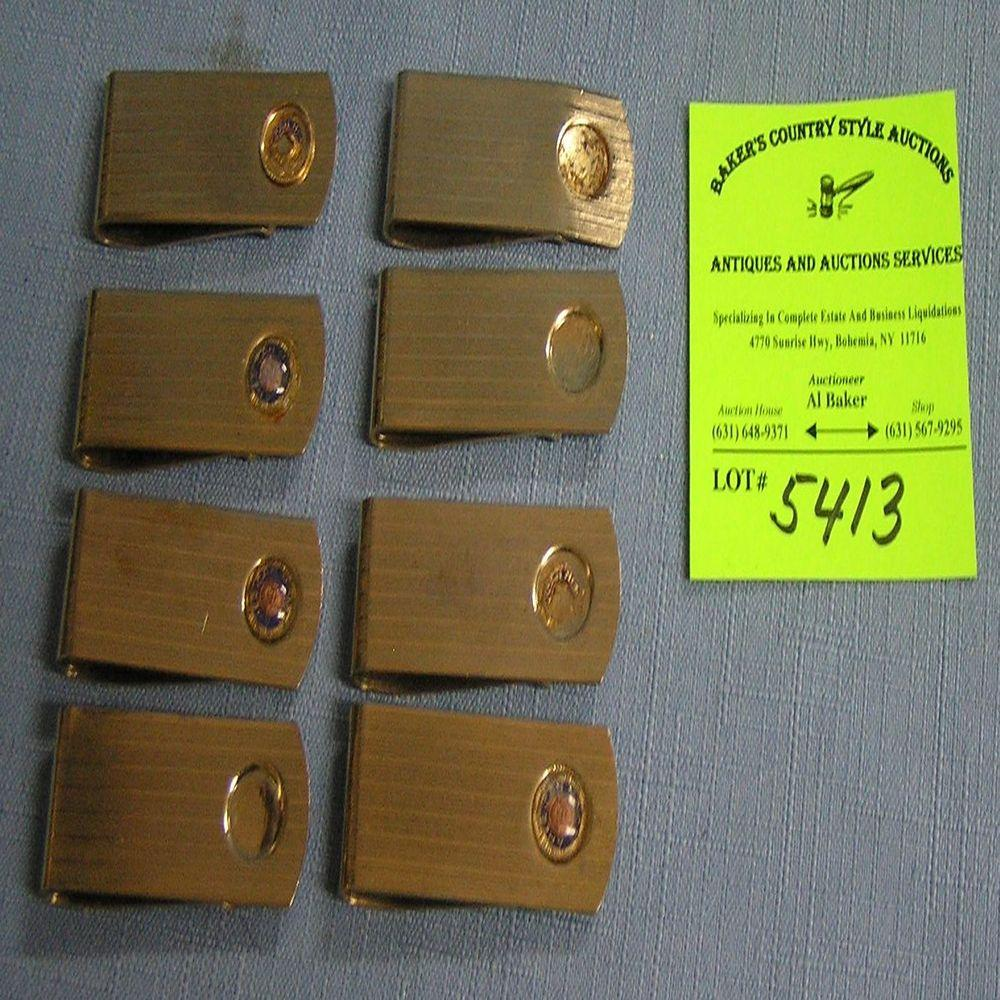 Group of gold plated money clips