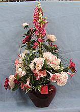 Porcelain vase with artificial flower arrangement