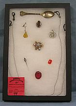Group of costume jewelry and souvenir spoon