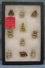 Collection of miniature figures by wade china of England