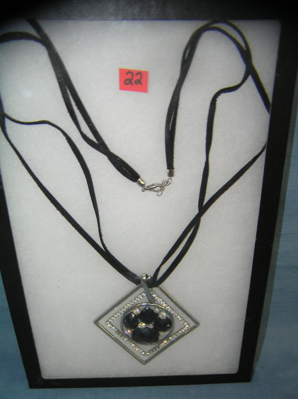 COSTUME JEWELRY NECKLACE WITH AN UNUSUAL PENDANT