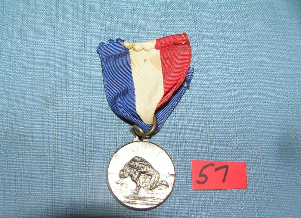 Lot 57: ANTIQUE SILVER TONED WRESTLING MEDAL AND RIBBON