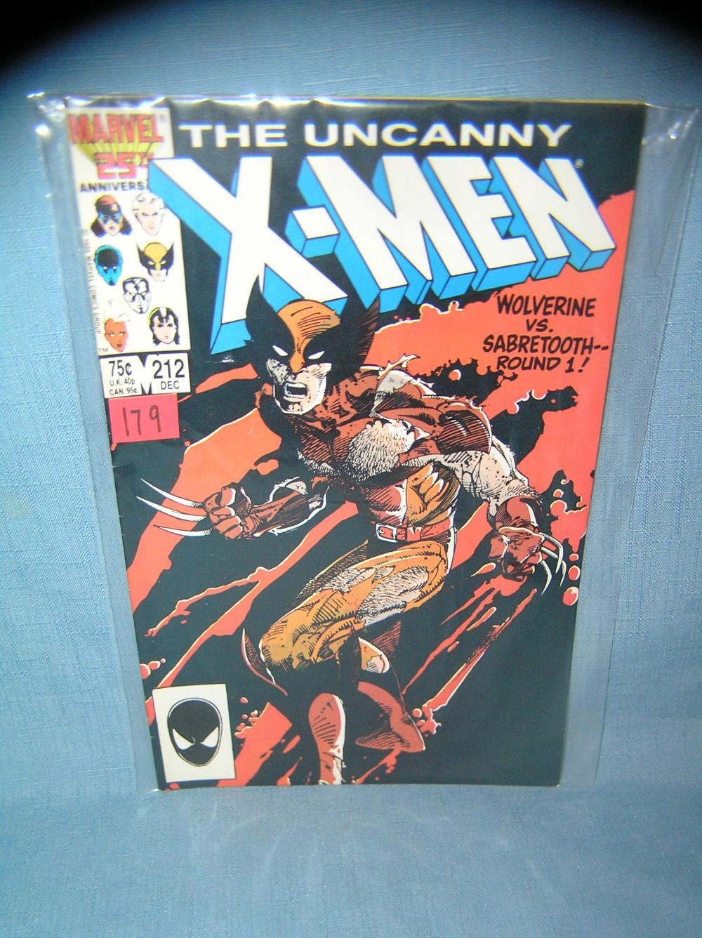 XMEN COMIC BOOK FEATURING WOLVERINE VS SABERTOOTH