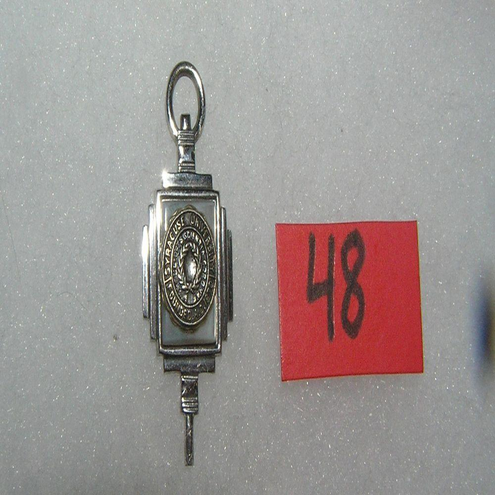 SYRACUSE UNIVERSITY GRADUATION PENDANT DATED 1955