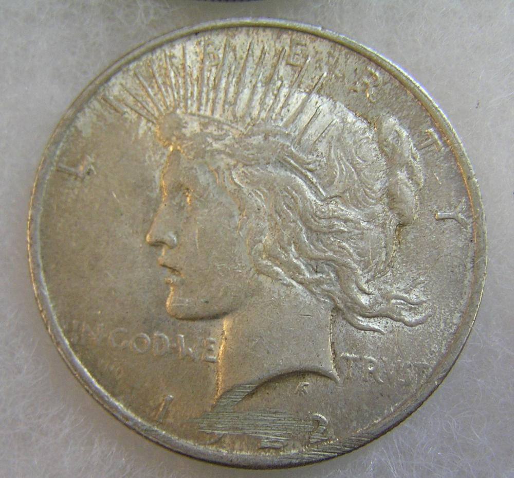 1922 LADY LIBERTY PEACE SILVER DOLLAR IN POOR CONDITION