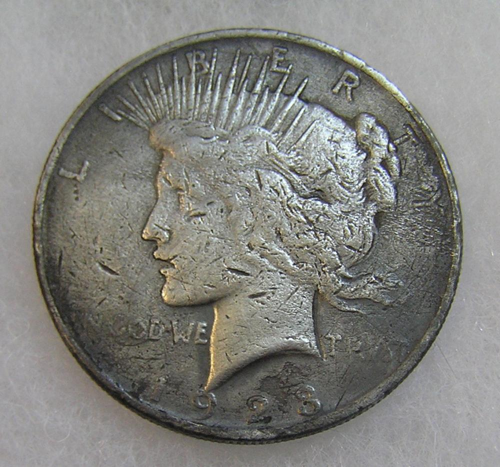 1923 LADY LIBERTY PEACE SILVER DOLLAR IN POOR CONDITION