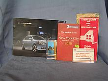 Group of vintage automotive and travel memorabilia