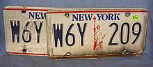 Pair of vintage NY license plates picturing the Statue of Liberty