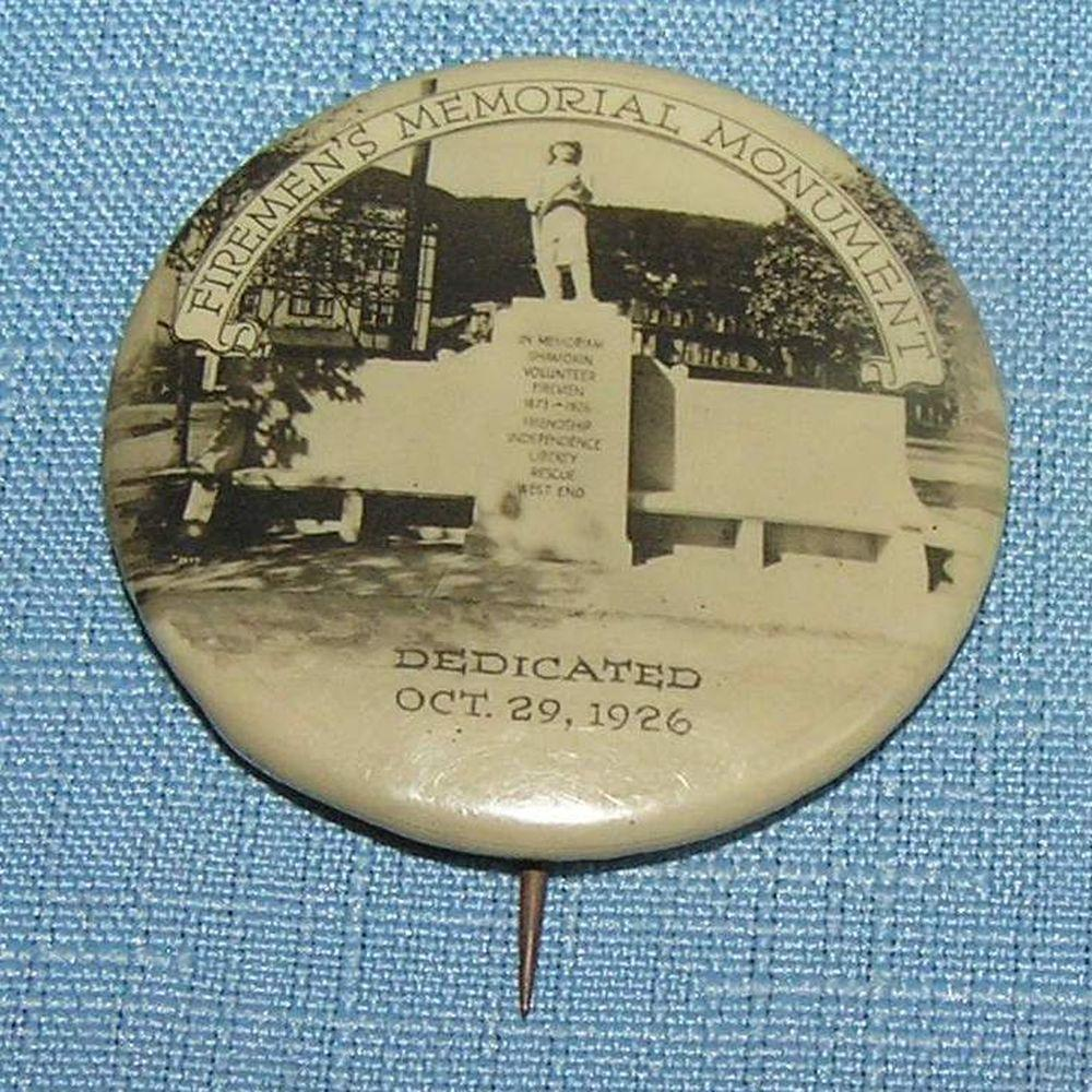 Antique celluloid fireman's pin back button