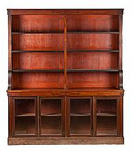 A mahogany French bookcase in Directory style and with ebony wood marquetry, from the last quarter of the 19th Century