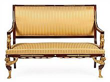 A mahogany French couch in Empire style with gold-plated bronze supports and decorations, from the last quarter of the 19h Century