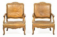 Pair of Louis XV-style carved beech armchairs, early 20th Century Leather upholstered seats. Damage to the upholstery. Slight flaws 10