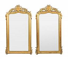 A pair of mirrors with Isabel of Spain frames in carved wood and gold-plated stucco, circa 1850-1870 One of them regilded