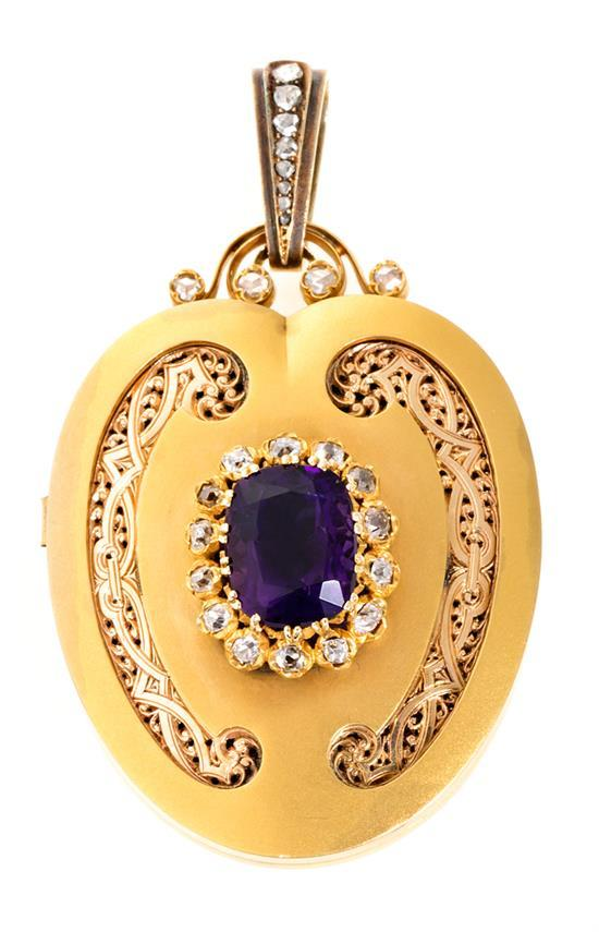 A pendant Locket in gold and precious stones, from the second half of the 19th Century