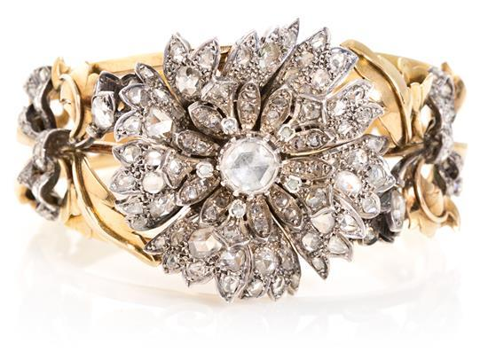 A Set of floral diamond bracelet, earrings and ring