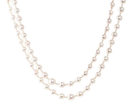 Collar largo de dos hileras de perlas