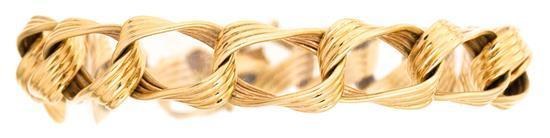 Pulsera en oro, de mediados del siglo XX
