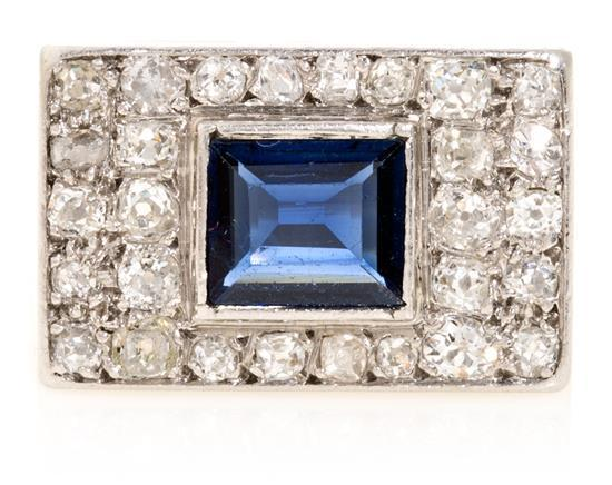 Central Sapphire and diamond ring