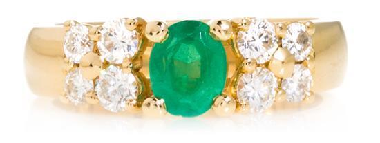 Sortija con esmeralda central y diamantes