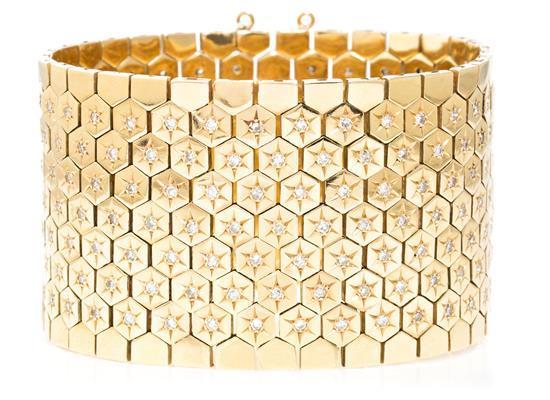 Pulsera ancha en oro y diamantes, de mediados del siglo XX