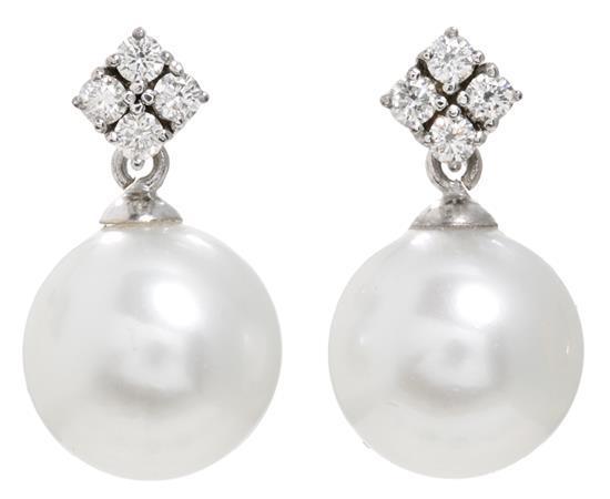 Pendientes colgantes de perlas y diamantes