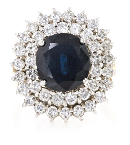 Sortija rosetón de zafiro central y diamantes