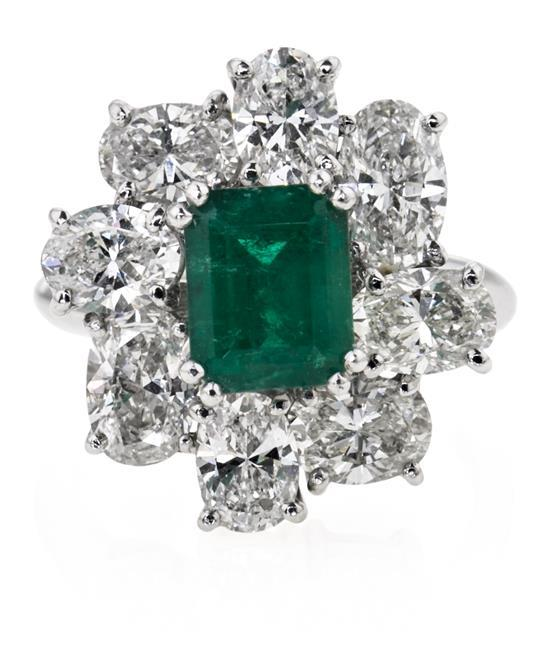Rosette ring with emerald and diamonds