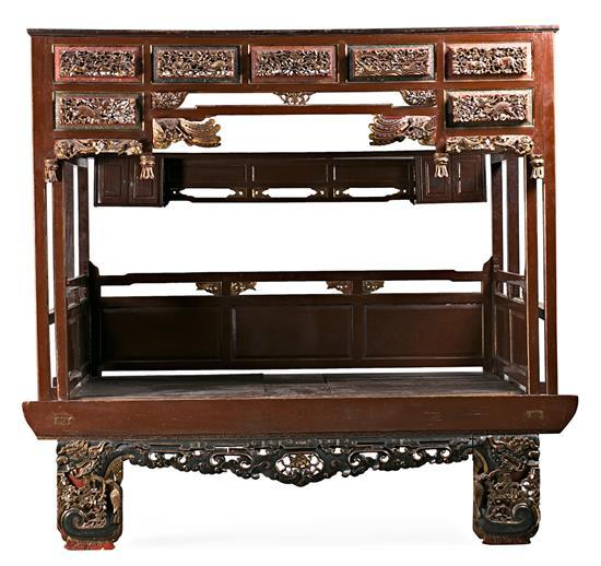 Chinese bed in carved, fretted, lacquered and gilded wood, late 19th-early decades of the 20th Century