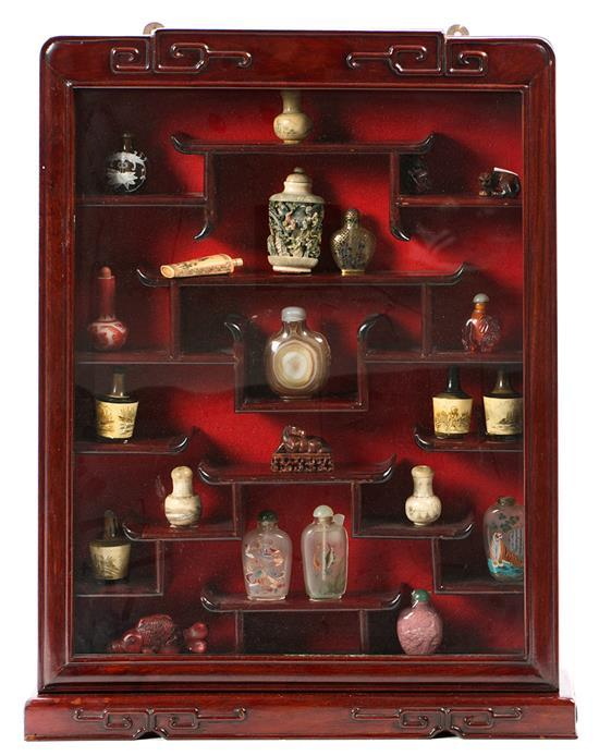 Chinese set of wooden shelves with 19 tobacco jars, two netsukes and one okimono, mid 20th century