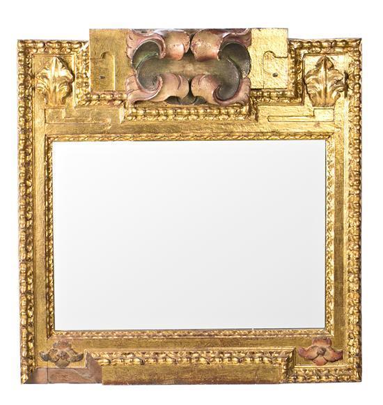 Espejo con marco español en madera pintada y dorada, elaborado con fragmentos de retablo del siglo XVII
