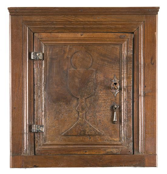 Tabernacle door in oak carved in relief, 17th Century