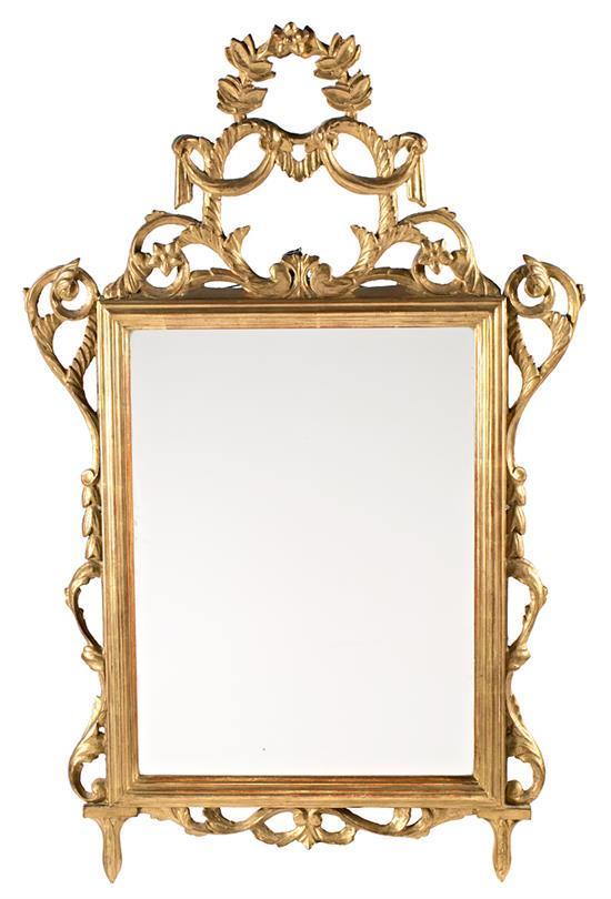Espejo con marco Carlos IV en madera tallada y dorada, de finales del siglo XVIII