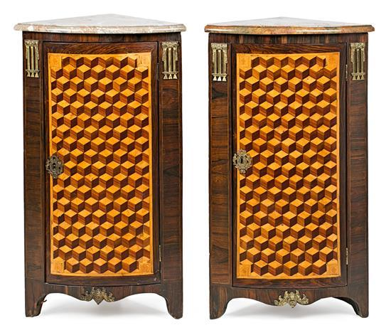 Pair of Louis XVI corner cupboards in rosewood with geometric marquetry in fine wood and gilt-bronze applications, last quarter of the
