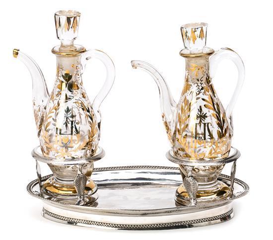 Bandeja de convoy barcelonesa en plata y pareja de vinajeras estilo dieciochesco en vidrio parcialmente dorado, del primer tercio de...