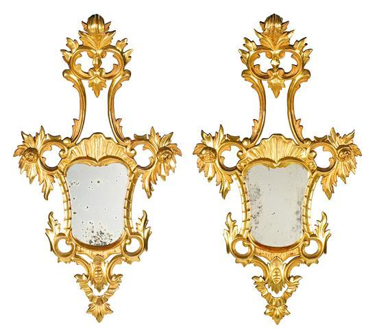 Pair of Charles III-style small decorative mirrors in carved, gilded and partially polychrome wood, 19th century