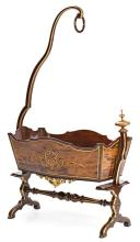 Alfonso XII mahogany cradle with gilt details and gilt carving, last quarter of the 19th century