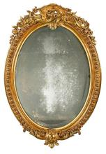 Isabella II oval-shaped mirror with frame in carved and gilded wood, second half of the 19th Century
