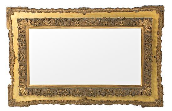 Espejo alfonsino con marco en madera y estuco dorados, hacia 1880