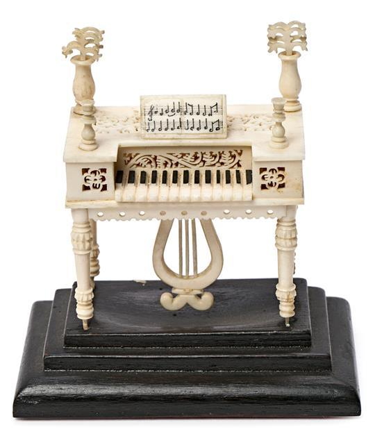Anglo-Indian miniature piano in fretted and stained ivory, probably from Calcutta, circa 1900