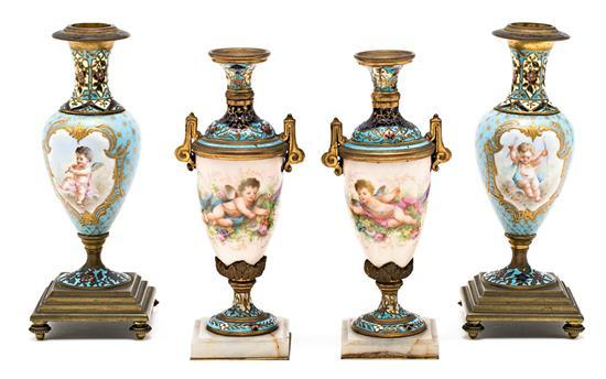 Two pairs of French vases in Limoges porcelain and