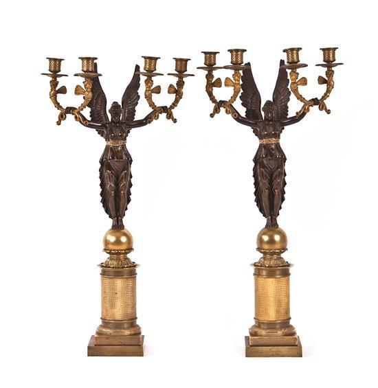 Pair of French Empire-style candelabra in blued and gilt bronze, late 19th century-first third of the 20th century