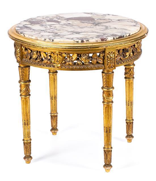 Mesa auxiliar estilo Luis XVI en madera tallada y dorada, de las primeras décadas del siglo XX