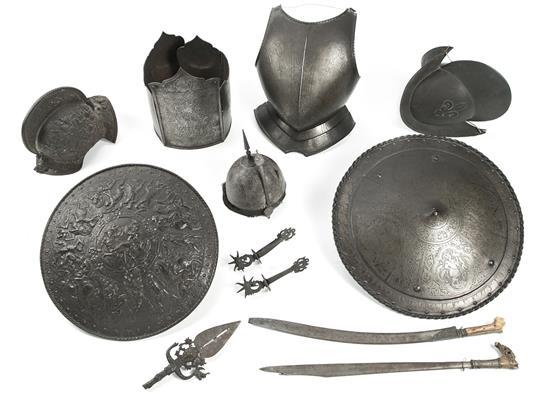 Pieces of Renaissance-style and Arab armour and oriental weapons in steel and bone, 19th century