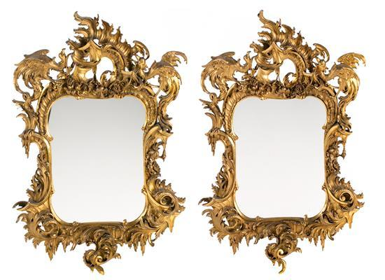 Pair of mirrors with gilded frames, probably French Rococo-style Art Nouveau, in carved wood and stucco, late 19th century